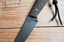 Slim and sharp utility knife in O1 carbon and linen micarta with black leather sheath.