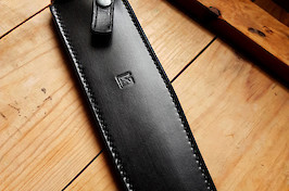 Dressed a a full-grain leather sheath